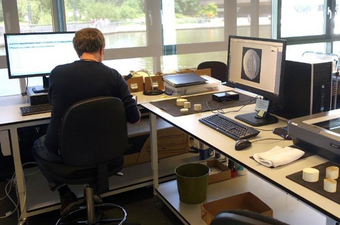 A volunteer sitting at his desk at The National Archives creating a PRO 23 image and associated metadata