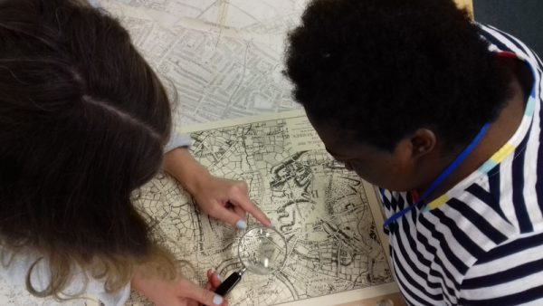 Share Students observe maps at Wandsworth Archives