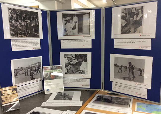 Close up of display at Roehampton Library showing photographic stills of CO1069 and INF10s.
