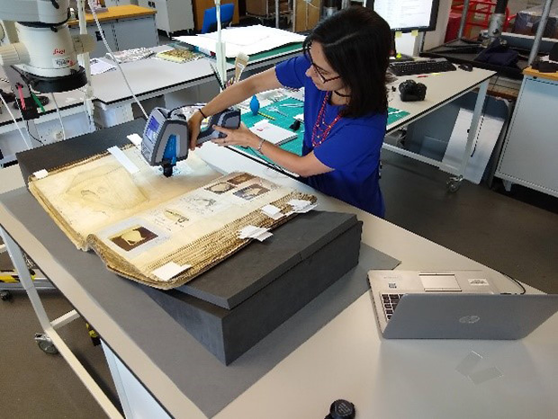 An archivist performs Fourier transform infra-red (FTIR) analysis on a pannotype print.