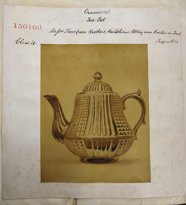 A hand-coloured albumen print of a tea pot.