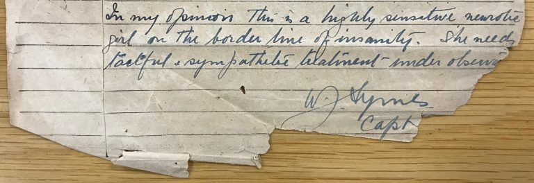 Extract of manuscript report on torn lined paper.