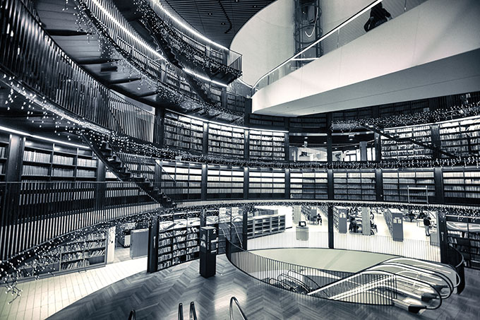 Black and white photograph showing a section of shelving at the Book Rotunda at the Library of Birmingham.