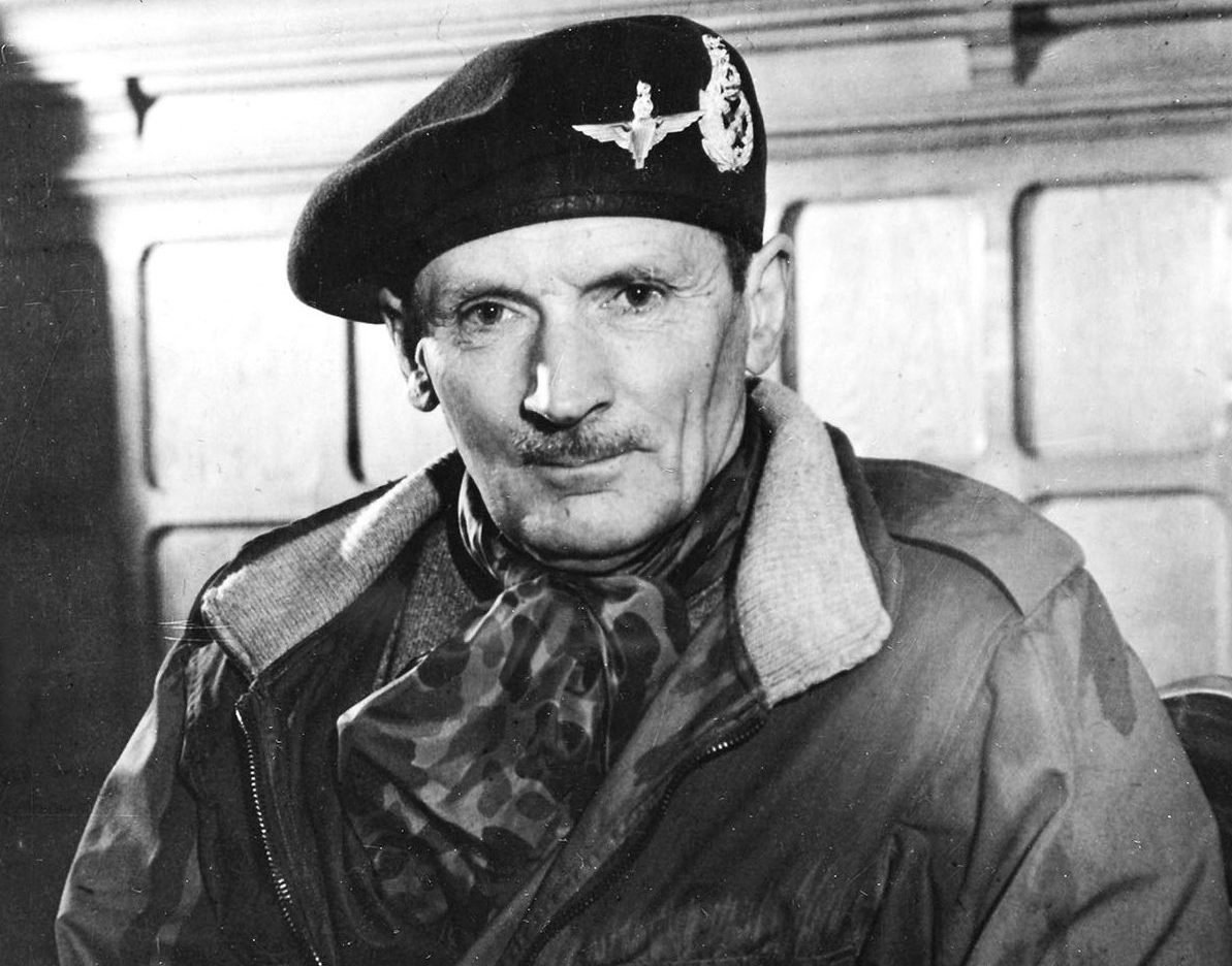 Black and white photograph of Field-Marshal Bernard Law Montgomery, commander of British 21st Army Group, photographed with British Airborne Cap badge and wearing a British camouflage paratrooper jacket, 1945.