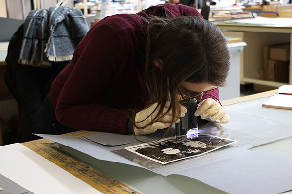 Young woman examining a photograph