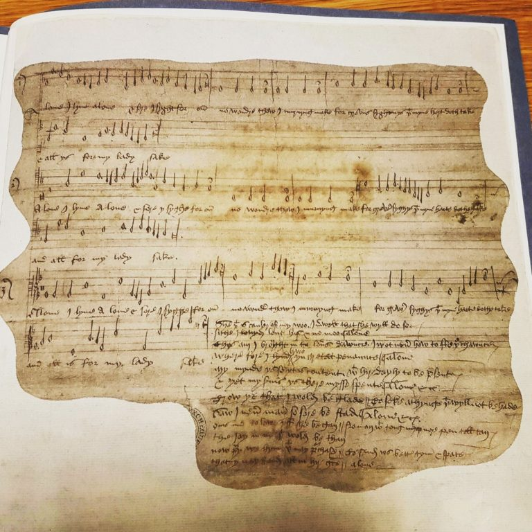 E 163/22/1/1 Doodled medieval love song written on the back of a report on a riot.