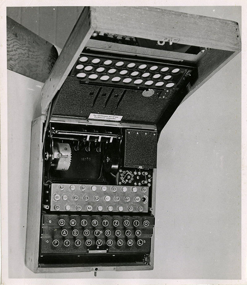 Black Enigma Machine in the 1940s. Catalogue ref: HW 25/26.and white photograph of the