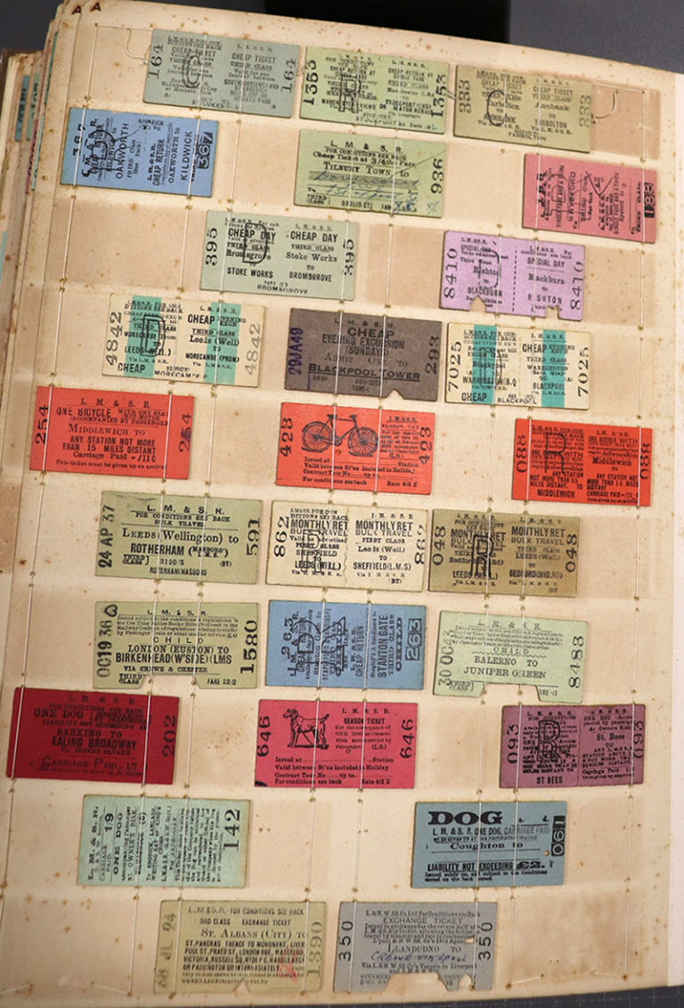 A page from a binder containing ten rows of train tickets for various destinations in the UK. Tickets are about one by two inches in size, different colours, some with images of a dog or a bicycle.