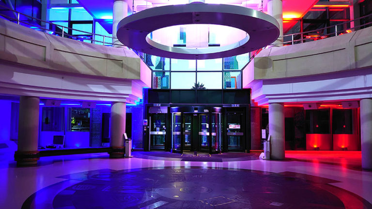 Colour photograph of the entrance to The National Archives lit up to celebrate VE Day.
