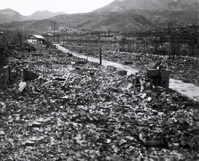 Black and white photograph showing the devastation caused by the atomic bomb blast at Nagasaki – HMS Speaker's evacuation of POWs from Nagasaki, September-October 1945.