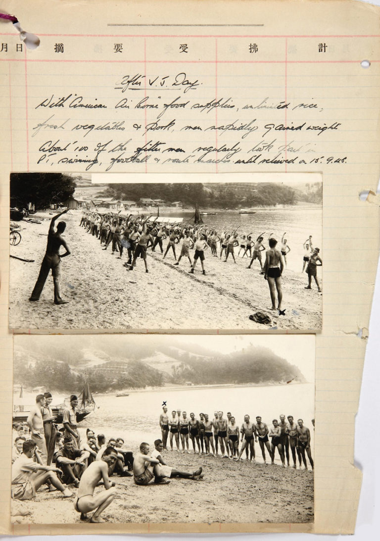 Page from a notebook featuring two photographs of recently-liberated British and Allied POWs taking part in PT exercises with US Airborne soldiers on a beach near Nagasaki. Using American supplies, along with locally-sourced food including fresh vegetables and meat, these former prisoners gained weight, and 100 of the fitter men were able to take part in PT drill, swimming, route marches and football matches. They departed Nagasaki after 15 September 1945.