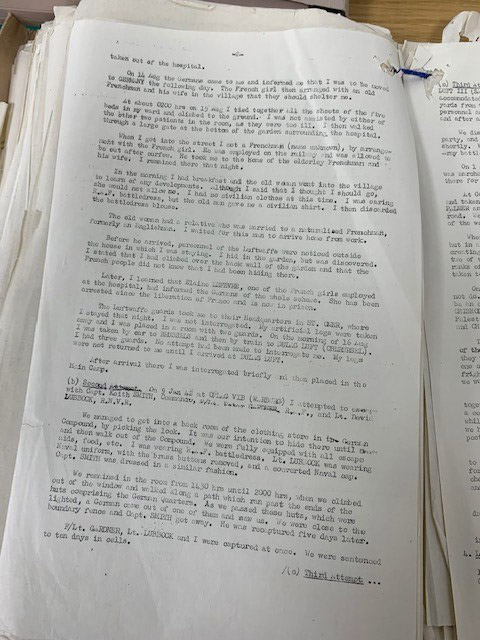The photograph shows a typed page from Bader's account of his attempted escapes from the hospital at St Omer on 15 August 1941.