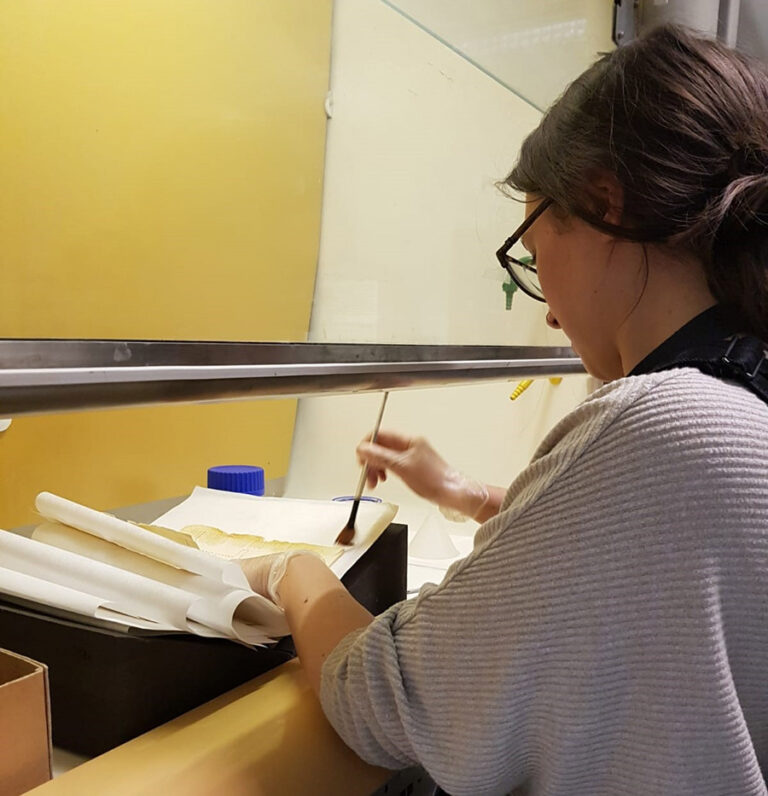 Harriet shown at work lining documents with 2% klucel-g in propan-2-ol in a fume cupboard.
