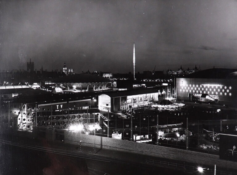 South Bank exhibition site by night, with the Lion and Unicorn Pavilion in the centre and the Royal Festival Hall to the right.
