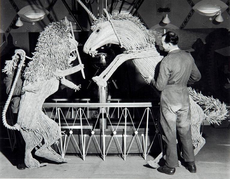 Black and white photograph showing Lion and Unicorn straw figures, 18 April 1951.