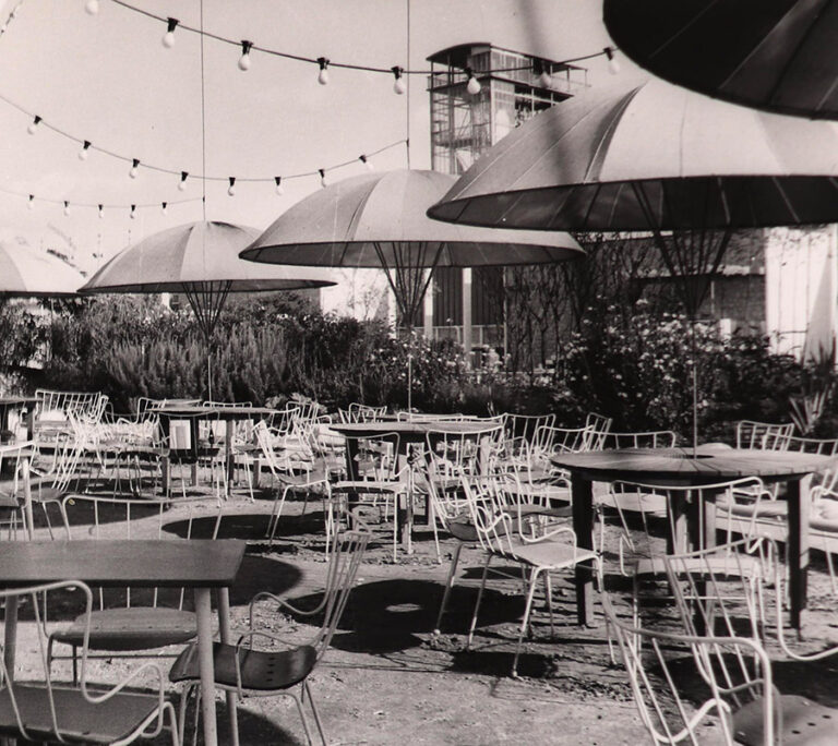 Photograph of tables on the terrace of the Unicorn Cafeteria.