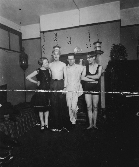 Black and white photograph of four individuals present during a raid of Fitzroy Square, used as evidence in 1927.