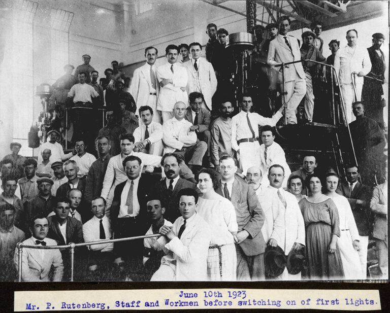 A posed photograph of approximately 50 people including Rutenberg, staff and workmen before switching on of first lights, Jaffa Electric Works, Palestine, 1923.