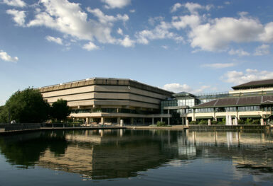 Exterior view of the National Archives building and pond.