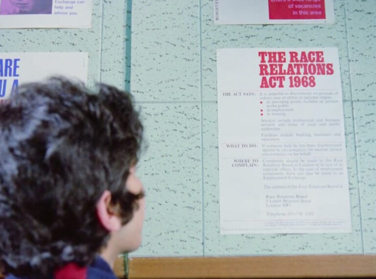 Still from 'Insaaf': Chhotu sees a poster about the Race Relations Act.