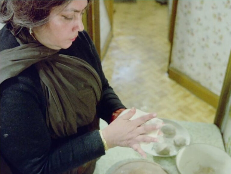 Still from 'Insaaf': Mrs Choudhry making chapatis.