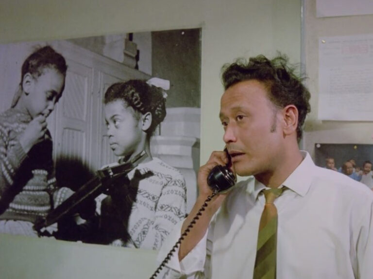 Still from 'Insaaf': Dilip Kapoor of the Race Relations Board telephoning Mr Appleby.