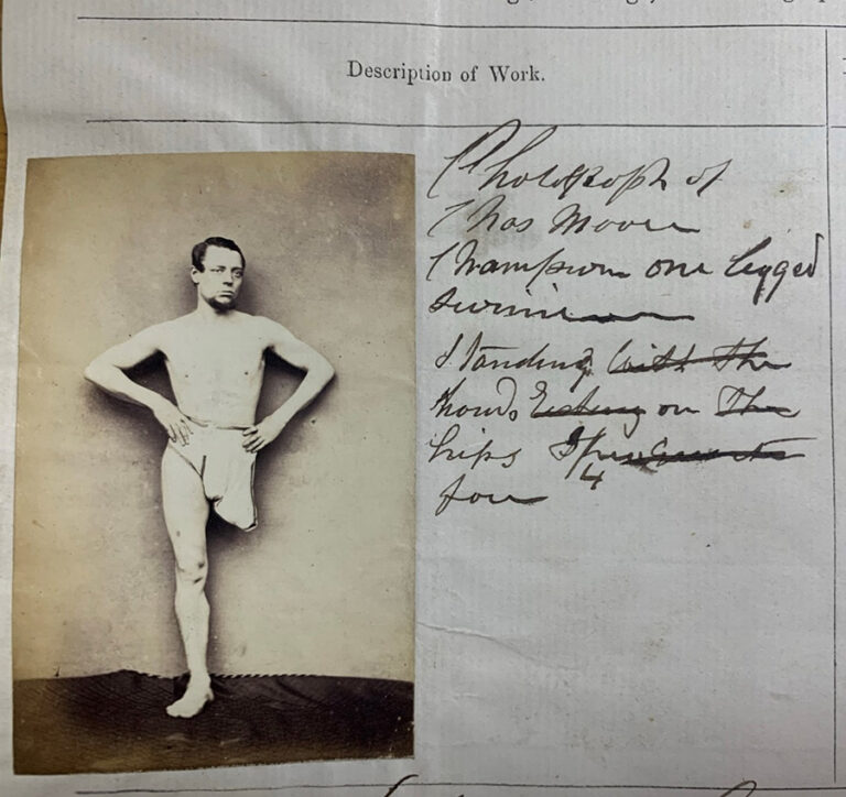 Photograph of Charles Moore, champion one legged swimmer, standing hands on hips, ¾ face.