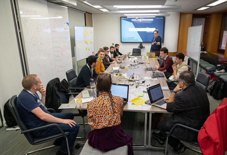 Participants sitting around a table.